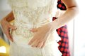 Free Bridesmaid Helping Bride To Dress Stock Images - 30127274