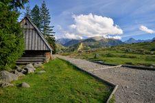 Free Cottage In Mountain Grassland Royalty Free Stock Photos - 30120988