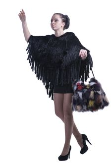 Free Fashionable Woman Walking In Black Poncho With Colorful Fur Bag And High-heel Shoes Stock Photos - 30121423