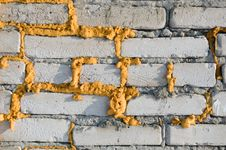 Brick Wall With Foam. Royalty Free Stock Photography