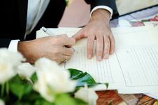 Free Groom Signing Wedding Contract Royalty Free Stock Images - 30138349
