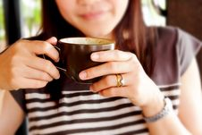 Woman Drinking Coffee At Rest Stock Photography