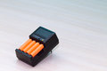 Free Black Charger With Orange Battery Stock Images - 30174984