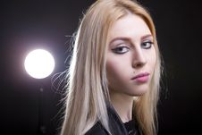 Portrait Of A Blonde With A Light Behind Her Royalty Free Stock Photography