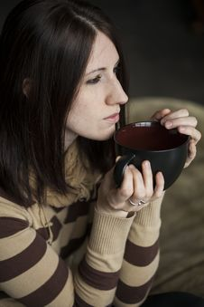 Young Woman With Brown Hair And Eyes Holding Black Cofee Cup Royalty Free Stock Photos