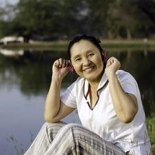 Beautiful Asian Woman Listening Music In Headphones Royalty Free Stock Photo