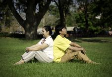 Free Portrait Of Beautiful Couple Sitting On Ground In Park Royalty Free Stock Photography - 30189177
