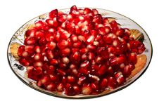 Pomegranate Grains On A Plate. Royalty Free Stock Images
