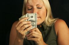 Free Woman Smelling Stack Of Money Stock Photos - 3025813