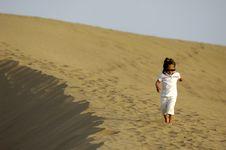 Child In Desert Stock Photo