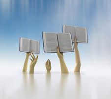 Arms Holding Three Books On Blue Blur Background Royalty Free Stock Photos