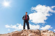 Free Man Standing On A Rock Stock Images - 30204384