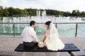 Free Happy Bride And Groom Near Fountain Stock Photo - 30216940