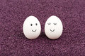 Free Two Smiling Eggs On Purple Sand. Royalty Free Stock Images - 30219389