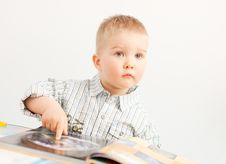 Free Curious Baby Boy Studying With The Book Royalty Free Stock Photo - 30222265
