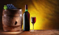 Free Bottle And A Glass Of Wine With A Wooden Barrel Stock Photography - 30242202