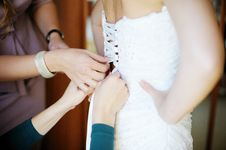 Free Female Hands Helping The Bride To Dress Stock Photos - 30263533
