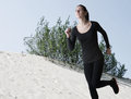 Free Woman In Black Running Over Sand Dunes Stock Images - 30271244