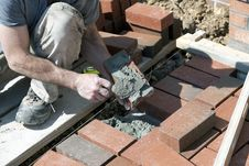 Free Brick Mason Applying Mortar. Stock Images - 30278694