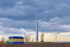 Wind Power Plant Near The House Royalty Free Stock Photography