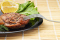 Free Grilled Steak With Salad And Lemon On Black Plate With Fork Stock Photos - 30283093