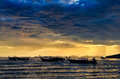 Free Ocean Coast Cloudy Colorful Sunset With Fishing Boats Royalty Free Stock Photos - 30298558