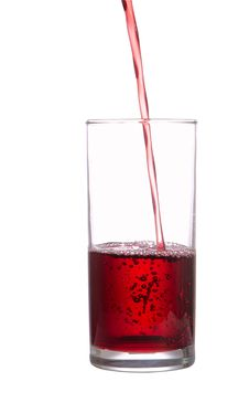 Stream Of Juice Flows In A Glass Royalty Free Stock Photography
