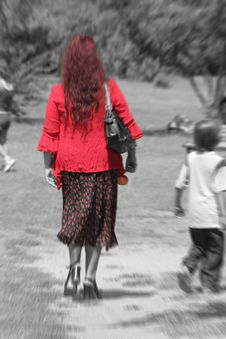 Red Lady In The Park Royalty Free Stock Photography