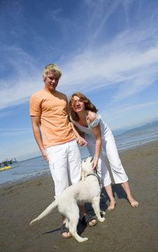 Free Young Couple On The Beach Royalty Free Stock Image - 3034406
