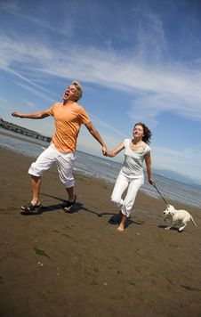 Free Young Couple On The Beach Stock Image - 3034491