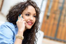Free Beautiful Mixed Woman In Urban Background On The Phone Royalty Free Stock Photos - 30301628