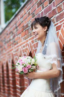 Free Happy Bride Near Ancient Wall Royalty Free Stock Image - 30303256