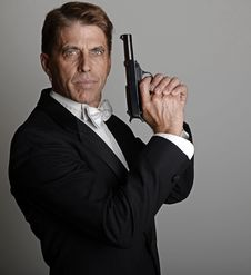 Free Handsome Man In Tuxedo With Gun Stock Image - 30306431