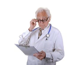 Free Senior Doctor Holding Chart With Glasses Royalty Free Stock Photography - 30308987