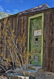 Green Door Of Abandoned Cabin Stock Image