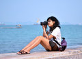 Free Young Female Photographer Taking Pictures On Beach Stock Photos - 30310243