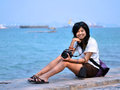 Free Young Woman Taking Pictures On The Beach Stock Images - 30310244