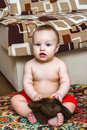 Free 10 Month Child Sitting With Toy And Looking Ahead Stock Photos - 30337973