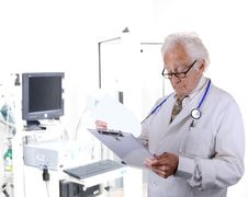 Free Doctor In Pulmonary Function Lab Looking At A Clipboard Stock Image - 30344931