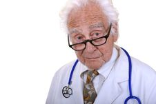 Senior Doctor In Glasses Looking Into Camera Stock Photo
