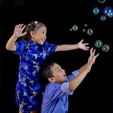 Children Playing With Bubbles Stock Images