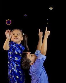 Free Philippino Children Playing With Bubbles Stock Photo - 30349650