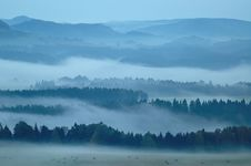 Free Hilly Landscape With Fog Stock Images - 30376274