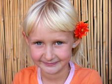 Free Child With Flower Behind Ear Stock Photography - 3041392