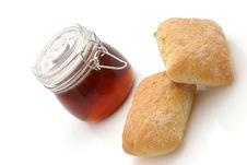 Honey And Bread Rolls Stock Photos