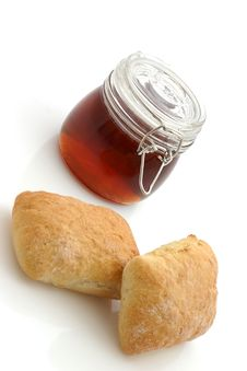 Honey And Bread Rolls Stock Photography