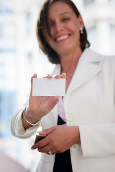 Free Woman With Business Card Across Office Royalty Free Stock Photo - 30413375