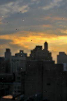 Rain Drops At Window With Unfocused Manhattan Skyline Royalty Free Stock Photos