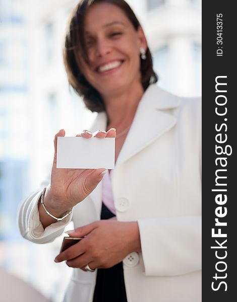 Woman with business card across office