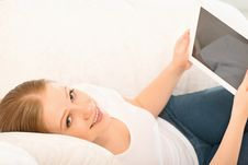Free Woman Relaxing At Home With A Tablet PC Royalty Free Stock Photography - 30445627